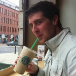 Aidan sipping a Starbucks coffee