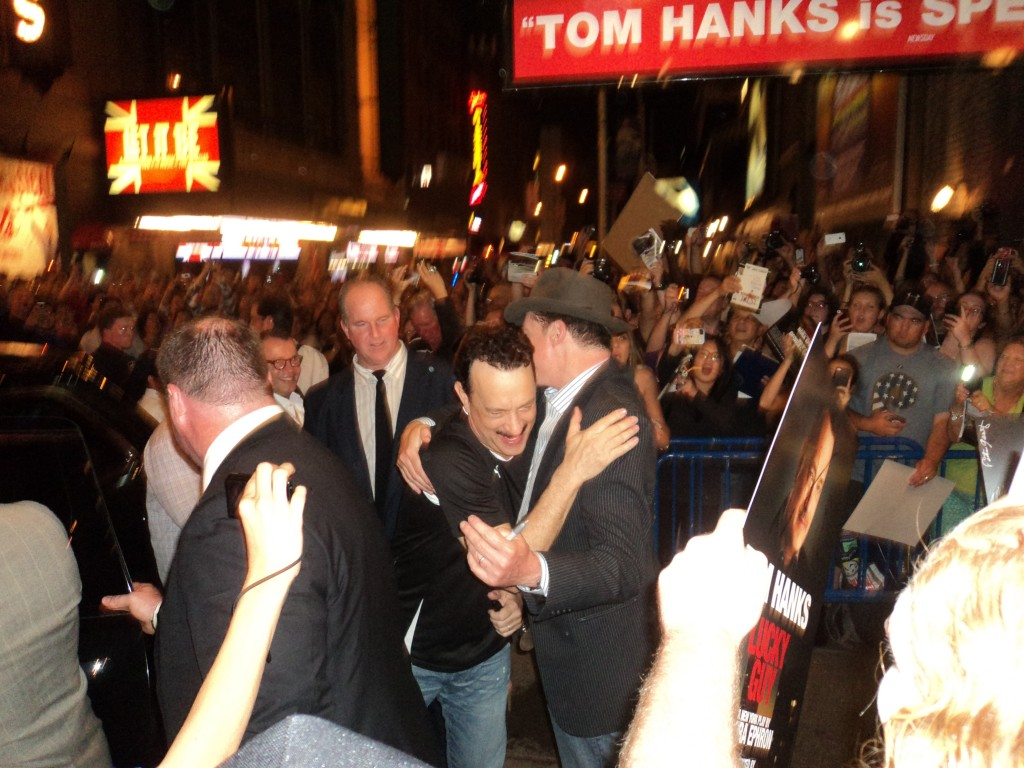 Tom hugging costar Christopher McDonald